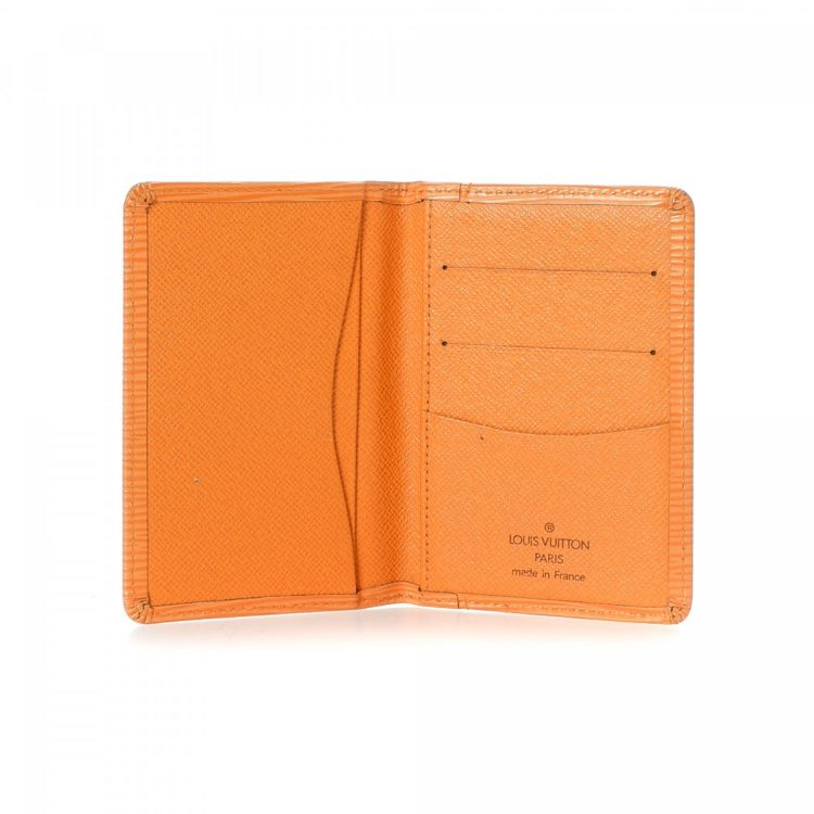 4f2994d3ea54 LXRandCo guarantees this is an authentic vintage Louis Vuitton Pocket  Organizer wallet. This refined card case in beautiful mandarin is made in  epi leather.