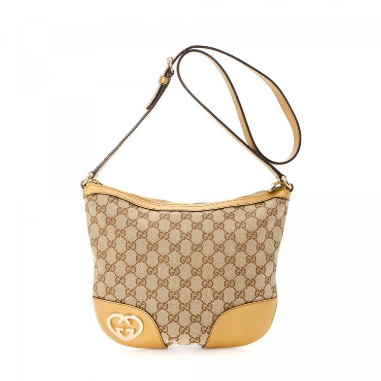 1d7902e71a9e The authenticity of this vintage Gucci Heart-shaped Interlocking G Crossbody  Bag shoulder bag is guaranteed by LXRandCo. This chic pocketbook in  beautiful ...