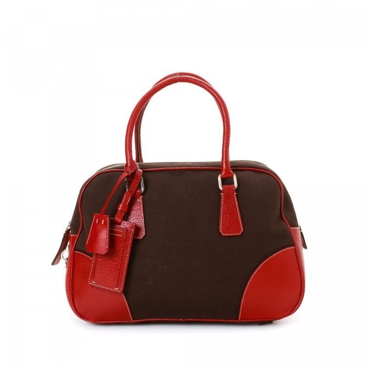 ... LXRandCo guarantees the authenticity of this vintage Prada Bowling Bag  handbag. Crafted in canvas ... 099386a99beb5