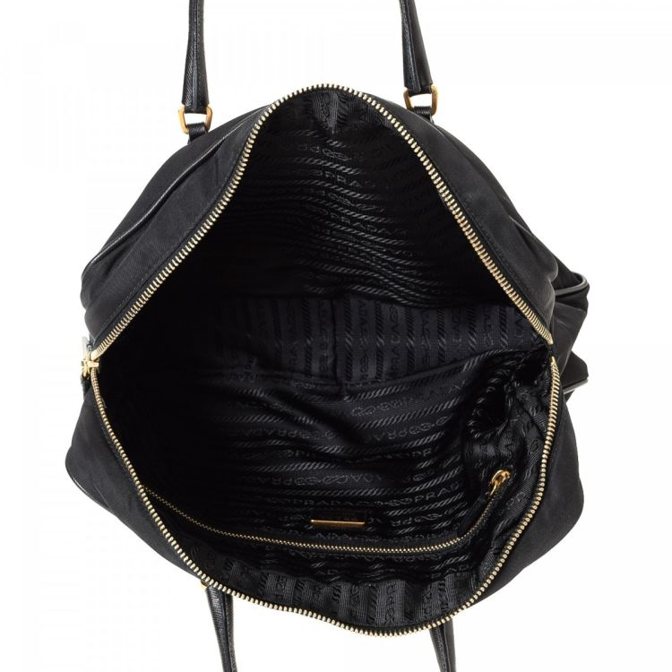 ... discount lxrandco guarantees this is an authentic vintage prada handbag.  crafted in tessuto nylon this a68f341a30d70