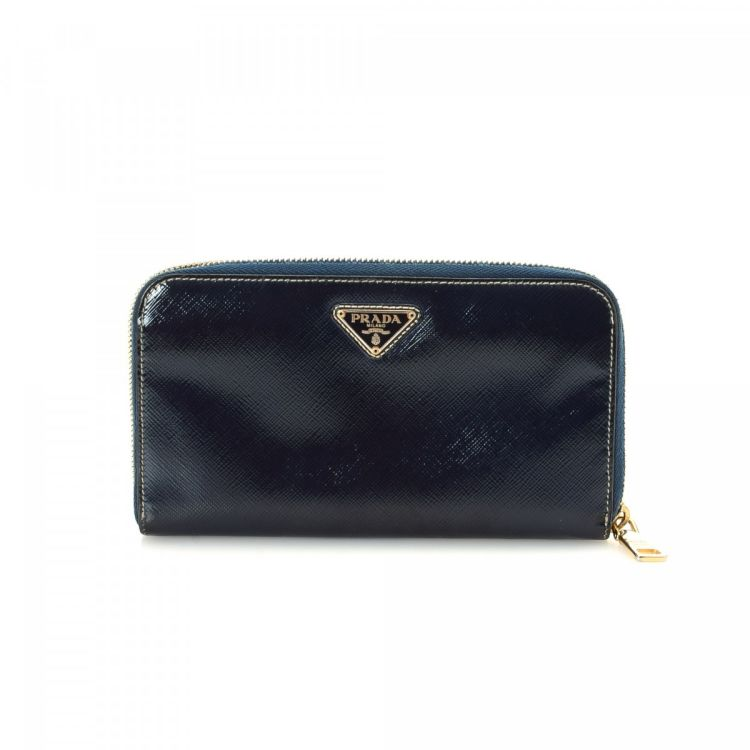 954b8a0f5886 ... france lxrandco guarantees the authenticity of this vintage prada wallet.  this sophisticated compact wallet was