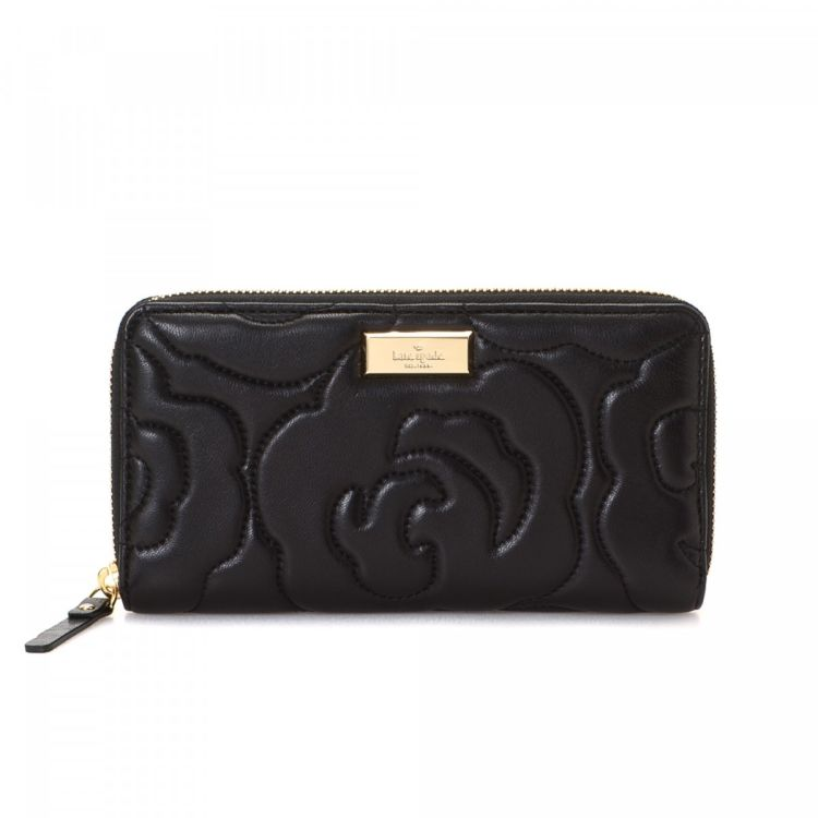 2962a2f875 LXRandCo guarantees the authenticity of this vintage Kate Spade Zip Around  wallet. Crafted in leather