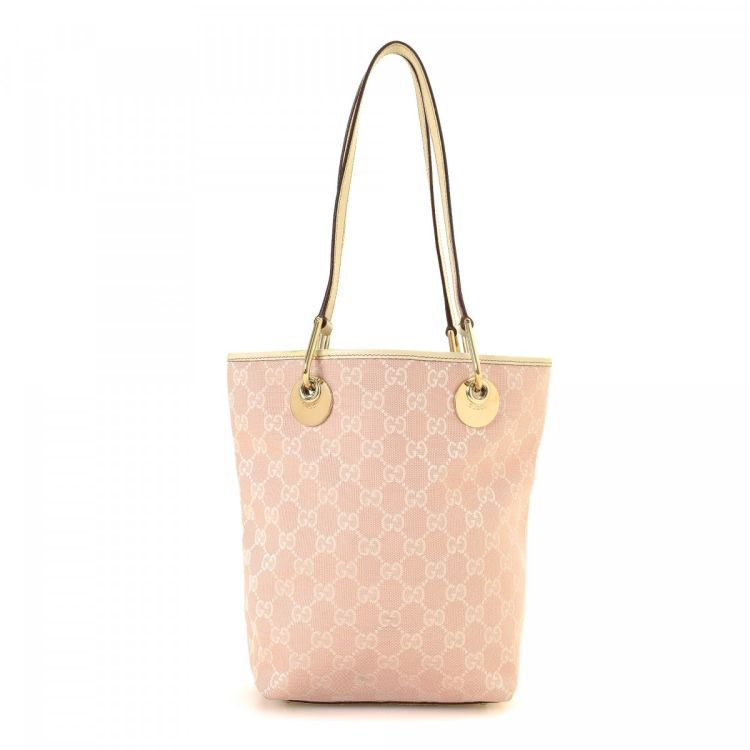 b000420028e9f0 The authenticity of this vintage Gucci tote is guaranteed by LXRandCo. This  sophisticated large handbag was crafted in gg canvas in light pink.
