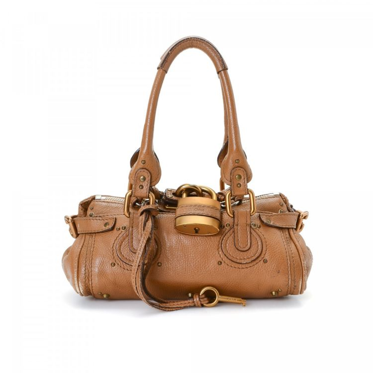 691678950329 The authenticity of this vintage Chloé Paddington handbag is guaranteed by  LXRandCo. This iconic bag comes in tan leather. Due to the vintage nature  of this ...