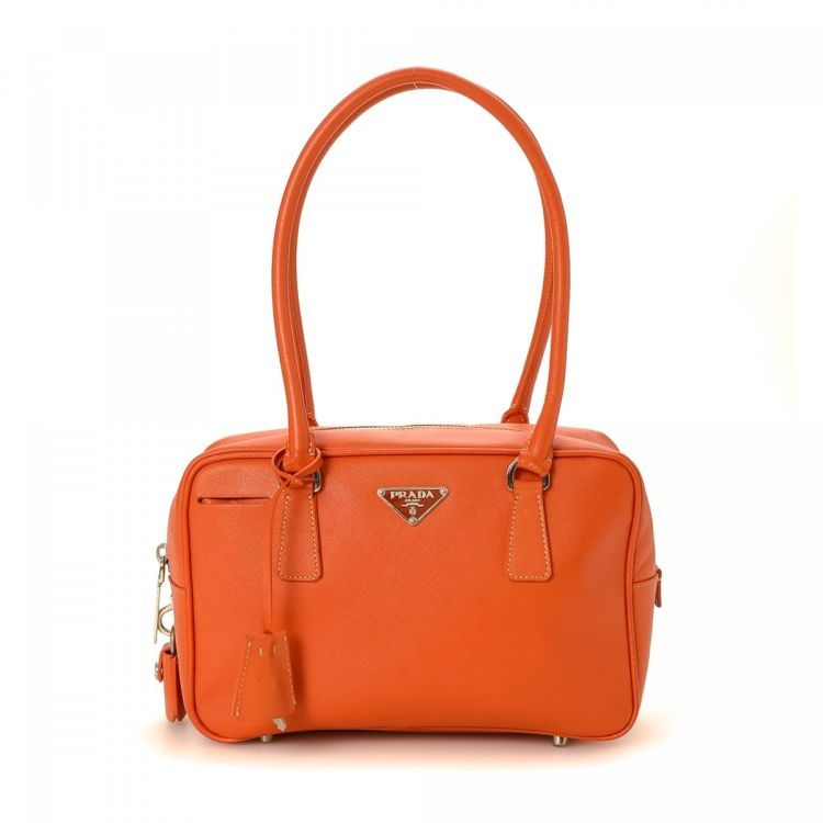 The authenticity of this vintage Prada handbag is guaranteed by LXRandCo.  This sophisticated handbag was crafted in saffiano leather in orange. ef7776734fa21