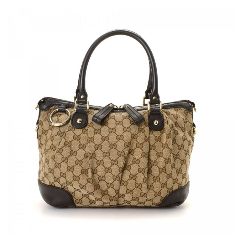 5af4407f290583 LXRandCo guarantees this is an authentic vintage Gucci Sukey Medium tote.  This luxurious bag was crafted in gg canvas in beautiful beige.