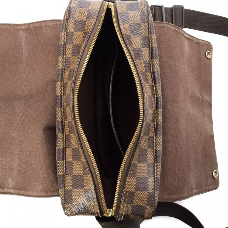 23d2a3a2c1f94 LXRandCo guarantees the authenticity of this vintage Louis Vuitton Naviglio  messenger   crossbody bag. This chic crossbody was crafted in damier ebene .