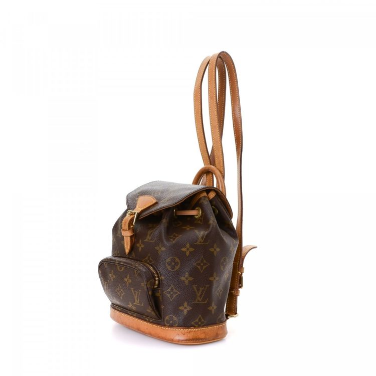 b7d98d28b71 LXRandCo guarantees this is an authentic vintage Louis Vuitton Montsouris  PM backpack. This chic rucksack in beautiful brown is made in monogram  coated ...