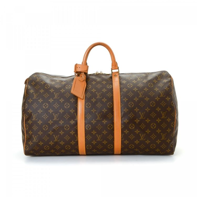 db37d3ac805f ... guarantees this is an authentic vintage Louis Vuitton Keepall 55 travel  bag. This luxurious weekender was crafted in monogram coated canvas in brown .