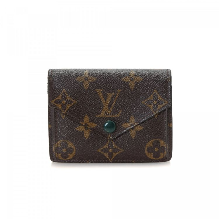 b2be49f902dc The authenticity of this vintage Louis Vuitton Marie wallet is guaranteed  by LXRandCo. Crafted in monogram coated canvas