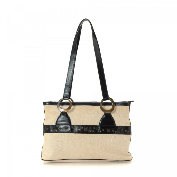 09ecd8a8fb The authenticity of this vintage Versace Small Bag tote is guaranteed by  LXRandCo. This signature tote was crafted in canvas in beige.