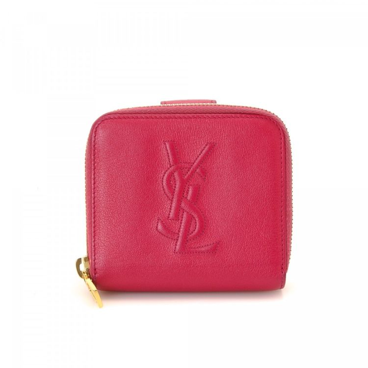 23e24de6a7f5 LXRandCo guarantees the authenticity of this vintage Yves Saint Laurent  Compact wallet. This iconic coin purse comes in beautiful fuchsia leather.