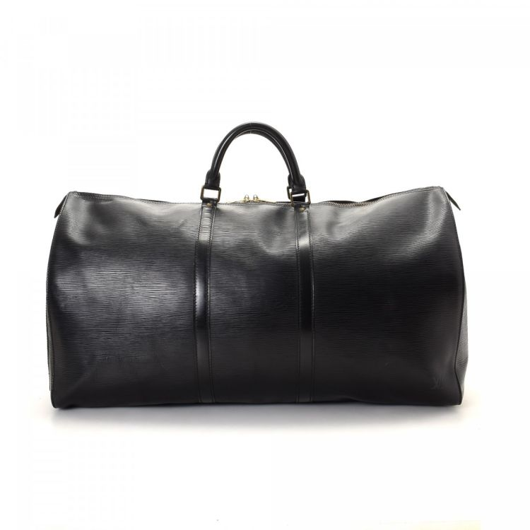 ec6ba29d154b ... of this vintage Louis Vuitton Keepall 60 travel bag is guaranteed by  LXRandCo. This lovely weekend bag in beautiful black is made in monogram  leather.