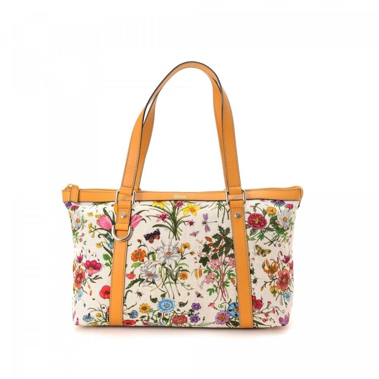 3c6f6b55c033 The authenticity of this vintage Gucci Fora tote is guaranteed by LXRandCo.  This sophisticated tote in beautiful multi color is made in flora canvas.