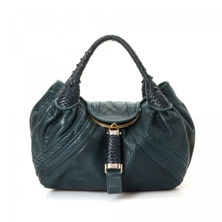 b0bb757a3237 LXRandCo guarantees this is an authentic vintage Fendi Spy Bag handbag.  This classic purse was crafted in leather in beautiful turquoise.