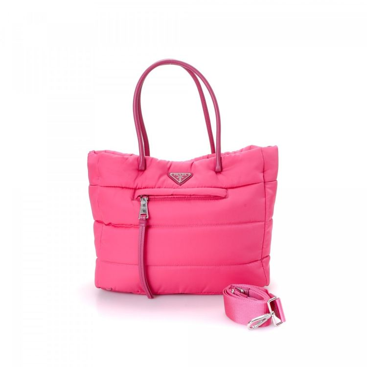 12d0c23e8c73 LXRandCo guarantees the authenticity of this vintage Prada Two Way Bag  shoulder bag. This chic bag was crafted in tessuto nylon in pink.