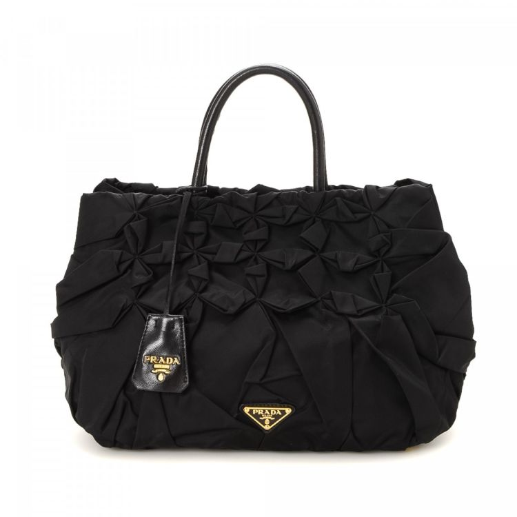 f6006e7f4037 The authenticity of this vintage Prada handbag is guaranteed by LXRandCo.  Crafted in tessuto nylon