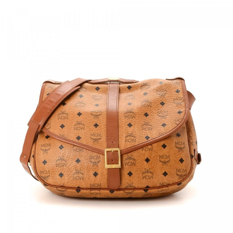 eee482ddb3 LXRandCo guarantees the authenticity of this vintage MCM Messenger Bag  messenger   crossbody bag. This chic pocketbook was crafted in visetos  coated canvas ...
