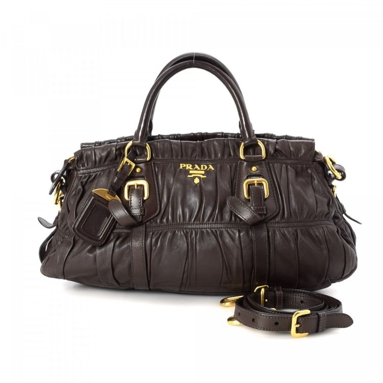 d6270d381809 LXRandCo guarantees this is an authentic vintage Prada Nappa Two Way Bag  handbag. This everyday purse was crafted in gaufre leather in brown.