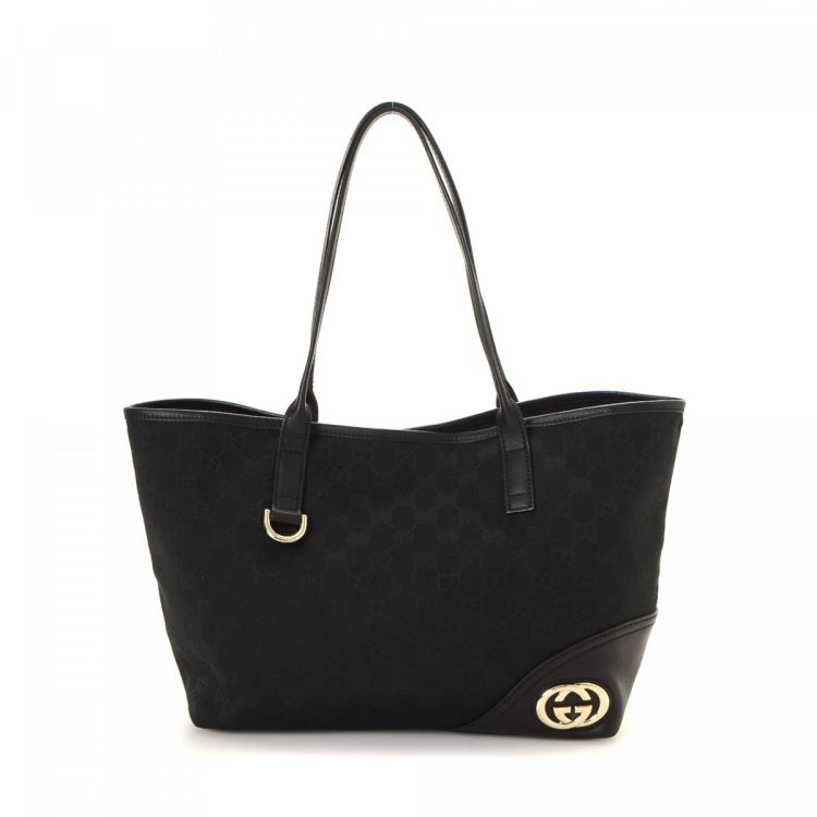 33f0bf33873 LXRandCo guarantees this is an authentic vintage Gucci New Britt tote. This  iconic bag comes in black canvas. Due to the vintage nature of this  product