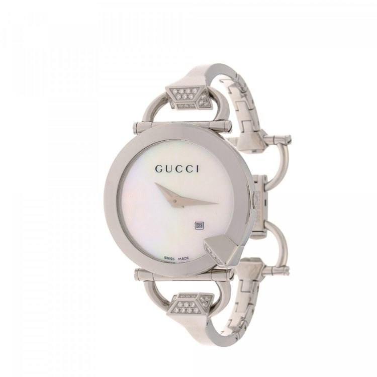 57c2f7c63f8 The authenticity of this vintage Gucci 122. 5 Chiodo Timepiece 35mm watch  is guaranteed by LXRandCo. This chic timepiece comes in silver stainless  steel.