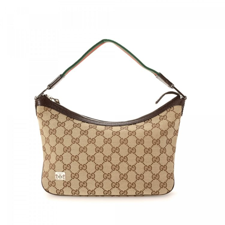 53a26860ecb LXRandCo guarantees the authenticity of this vintage Gucci Hobo Bag  shoulder bag. This stylish shoulder bag in beige is made in gg canvas.