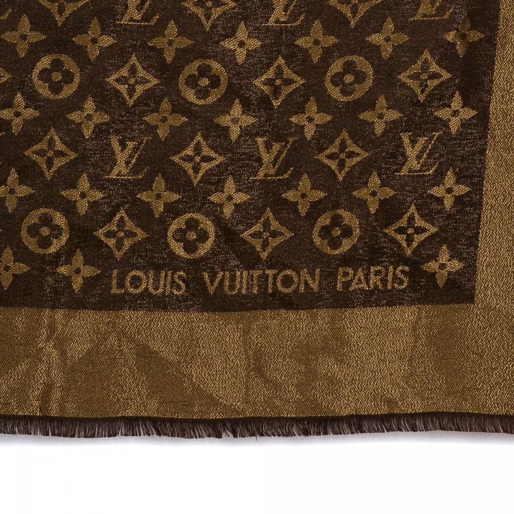 57e2e3b4d6c4 LXRandCo guarantees the authenticity of this vintage Louis Vuitton Shawl  scarf. This classic scarf was crafted in monogram silk in brown.