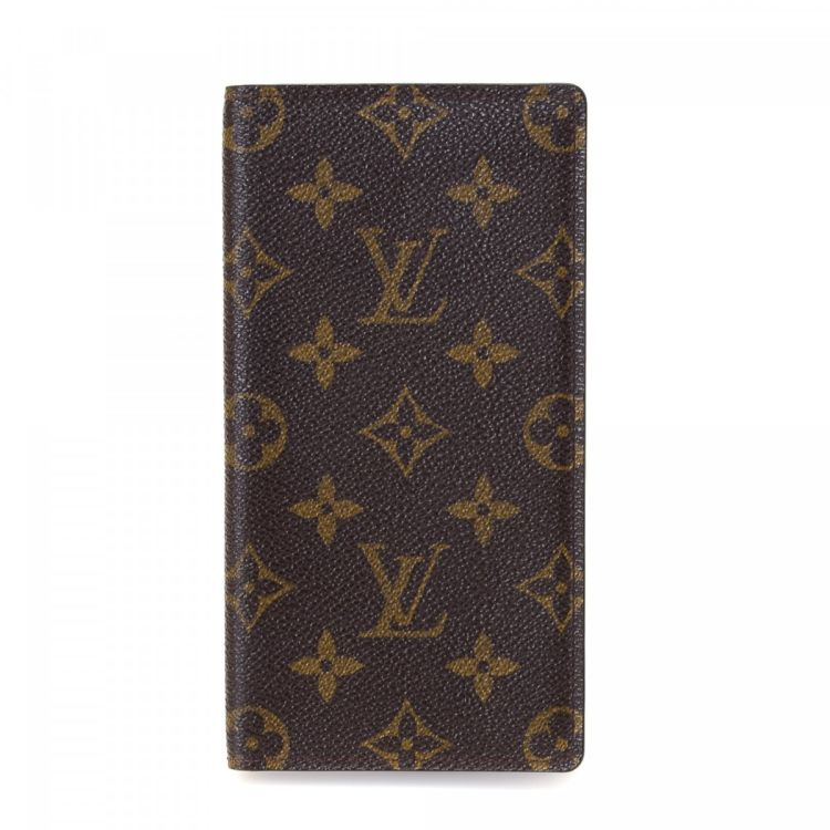 cd0869796701 LXRandCo guarantees this is an authentic vintage Louis Vuitton Checkbook  Cover wallet. Crafted in monogram coated canvas