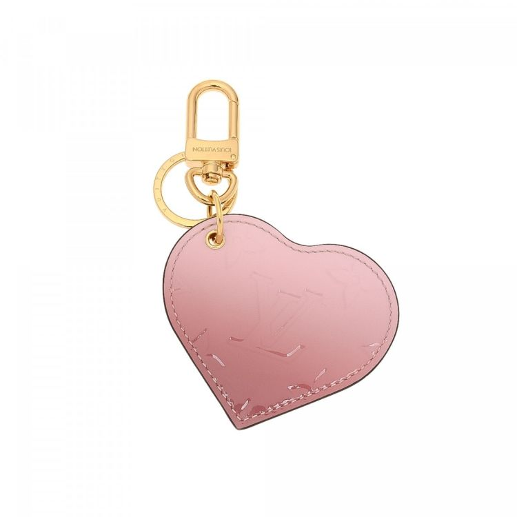 869939156b8e The authenticity of this vintage Louis Vuitton Bag Charm other accessory is  guaranteed by LXRandCo. This practical accessory in beautiful light pink is  made ...