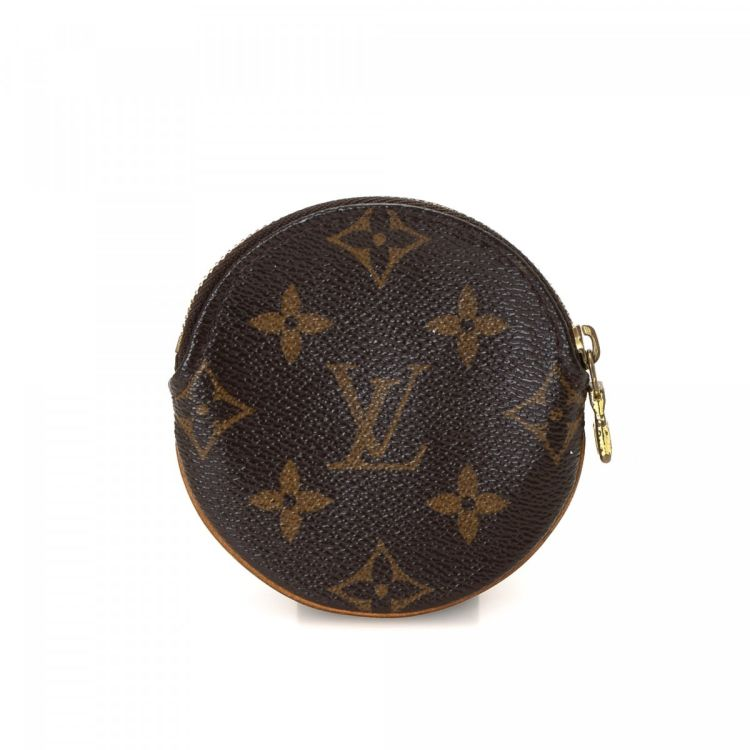 88100c8bb6a1 The authenticity of this vintage Louis Vuitton Round Coin Purse wallet is  guaranteed by LXRandCo. This luxurious card case was crafted in monogram  coated ...