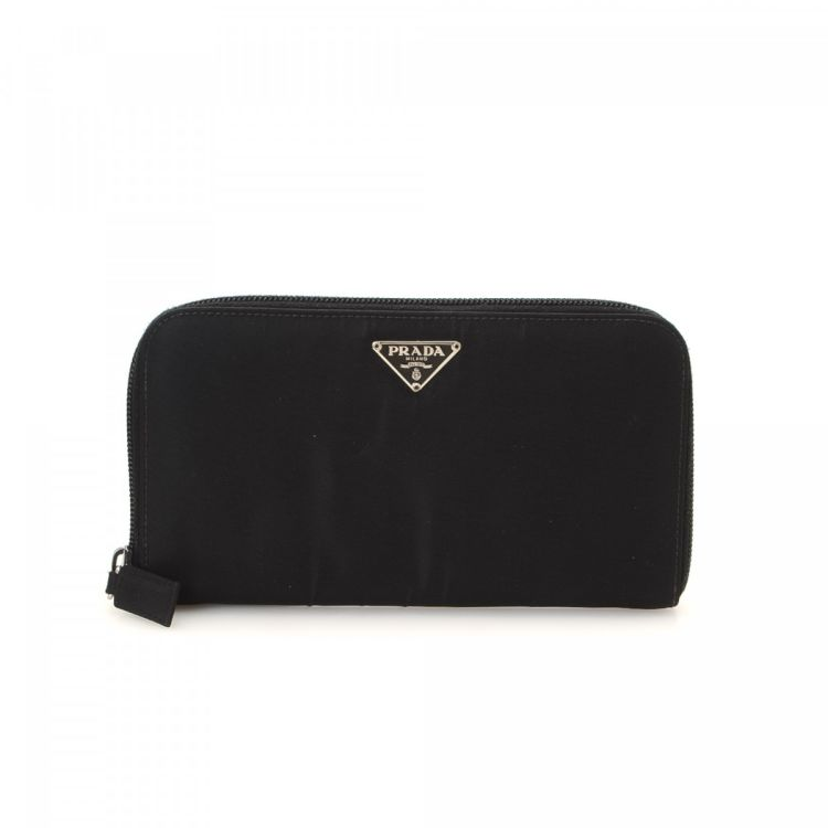 c1a020f3598852 LXRandCo guarantees the authenticity of this vintage Prada Zip Around wallet.  Crafted in tessuto nylon, this chic billfold comes in beautiful black.