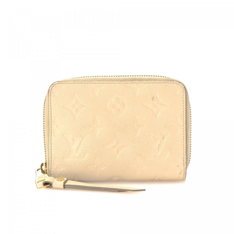 813f83aab895 LXRandCo guarantees the authenticity of this vintage Louis Vuitton Secret  Compact wallet. This chic coin purse in beautiful neige is made in monogram  ...