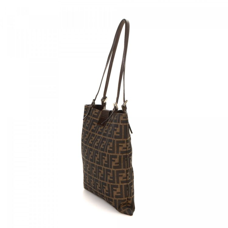 917d7e7a4ec2 LXRandCo guarantees the authenticity of this vintage Fendi Small Bag tote.  This sophisticated large handbag was crafted in zucca canvas in beautiful  brown.