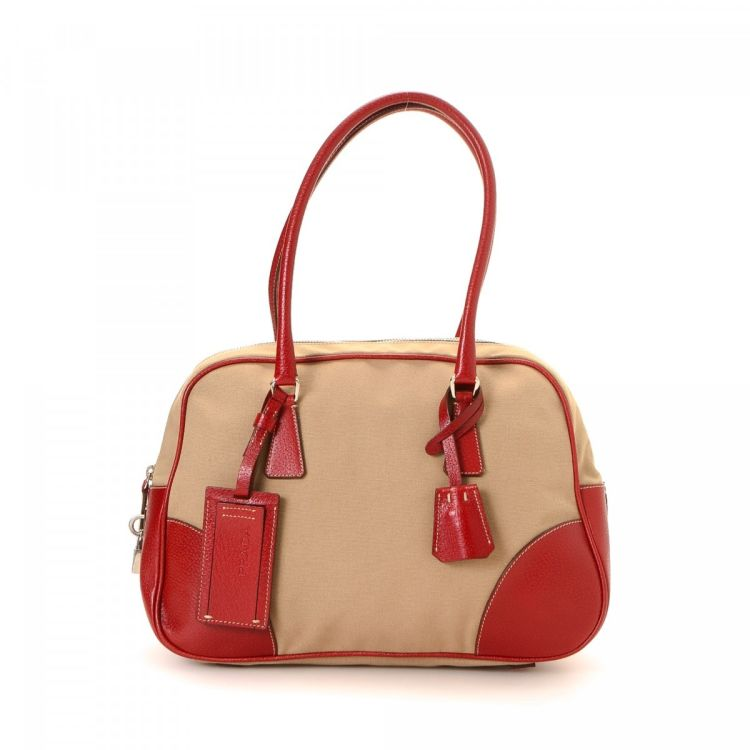 f194131c427129 LXRandCo guarantees the authenticity of this vintage Prada Small Boston Bag  travel bag. This beautiful satchel was crafted in canapa canvas in beige.