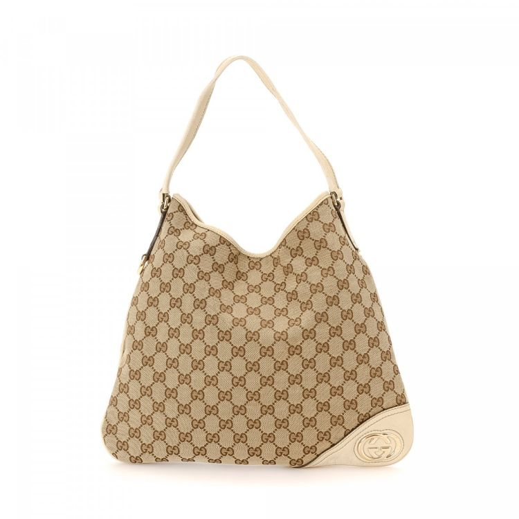 09ee2a0619bf LXRandCo guarantees this is an authentic vintage Gucci New Britt Hobo Bag  handbag. Crafted in gg canvas, this everyday purse comes in beautiful beige.