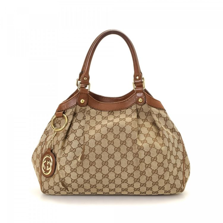 b7eaafba2254 LXRandCo guarantees the authenticity of this vintage Gucci Sukey Tote Bag  shoulder bag. Crafted in gg canvas, this signature shoulder bag comes in  beige.