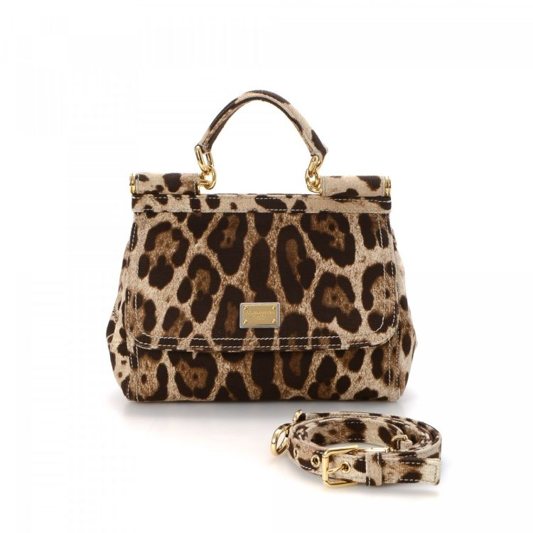 52a0949dc09b LXRandCo guarantees the authenticity of this vintage Dolce   Gabbana  Leopard Sicily handbag. This practical bag was crafted in canvas in brown.