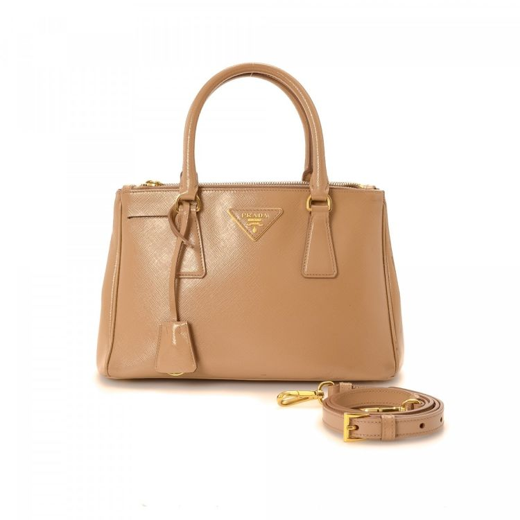 e7f1108ddf9b LXRandCo guarantees this is an authentic vintage Prada Two Way Bag handbag.  Crafted in saffiano leather, this signature pocketbook comes in beautiful  beige.