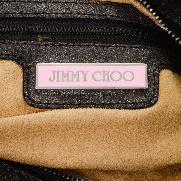 9e1538b65f The authenticity of this vintage Jimmy Choo shoulder bag is guaranteed by  LXRandCo. This classic shoulder bag was crafted in leather in beautiful  black.