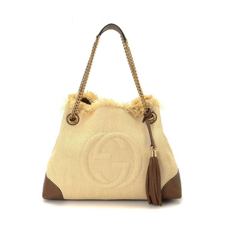 4d400ecd33fd LXRandCo guarantees the authenticity of this vintage Gucci Soho Chain tote.  This sophisticated work bag in beautiful beige is made of straw.