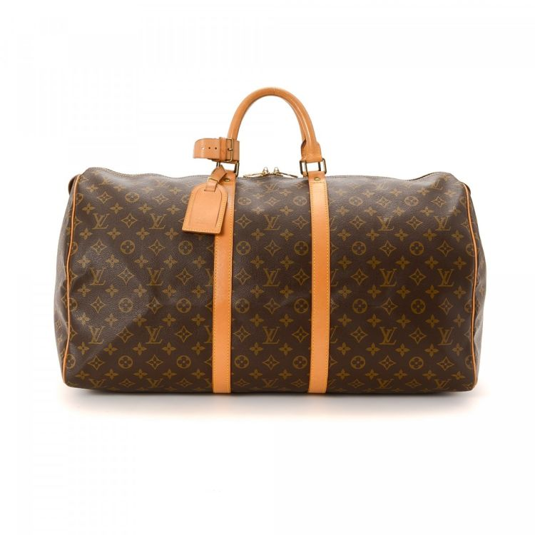 c2c5ed3a8b49 LXRandCo guarantees this is an authentic vintage Louis Vuitton Keepall 55  travel bag. This lovely weekend bag was crafted in monogram coated canvas  in ...
