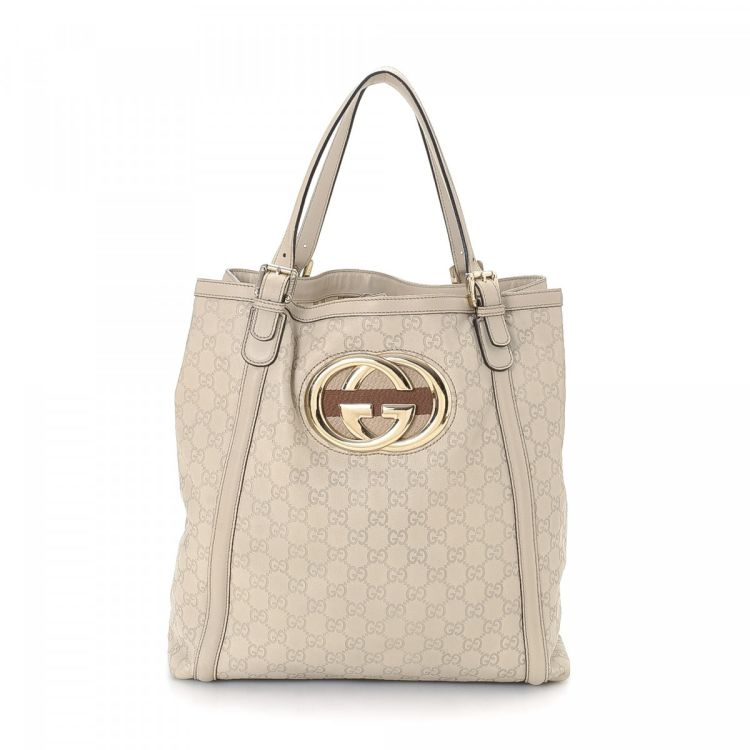 a74ebe8d825c50 LXRandCo guarantees the authenticity of this vintage Gucci Britt Bag tote.  This stylish work bag in white is made in guccissima leather.