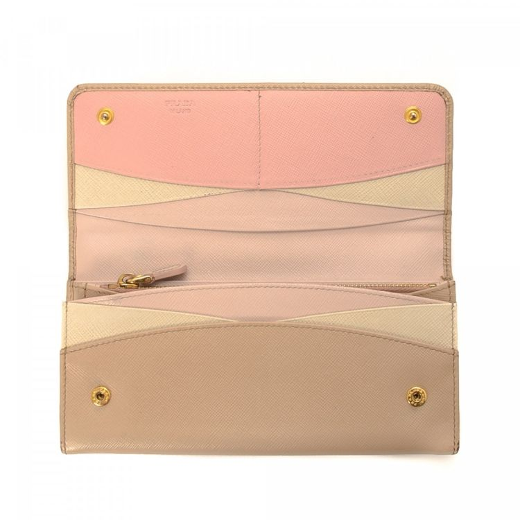 ... reduced the authenticity of this vintage prada long wallet is guaranteed  by lxrandco. this exquisite 025938f7d3f17
