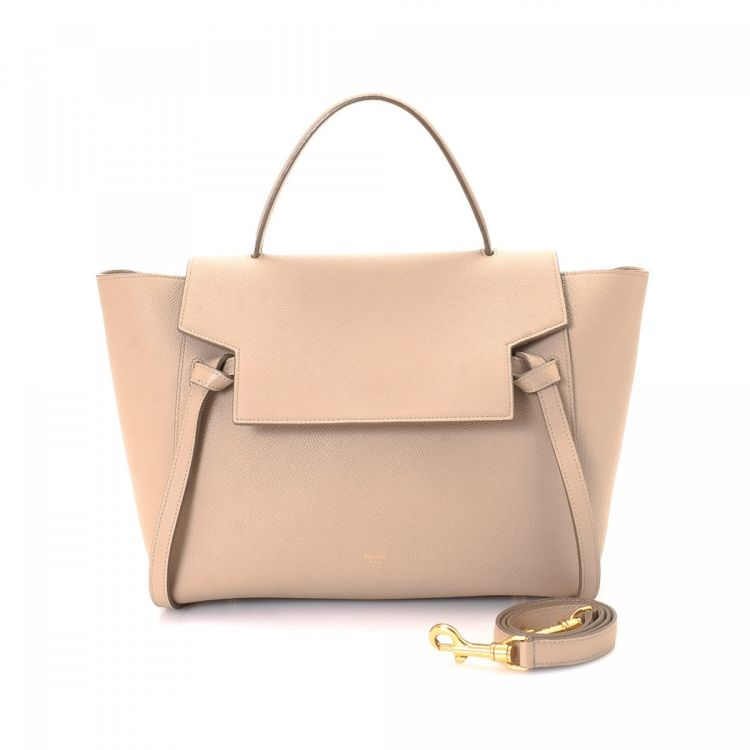 cce8d91efb LXRandCo guarantees this is an authentic vintage Céline Belt Bag handbag.  This classic pocketbook comes in taupe leather. Due to the vintage nature  of this ...