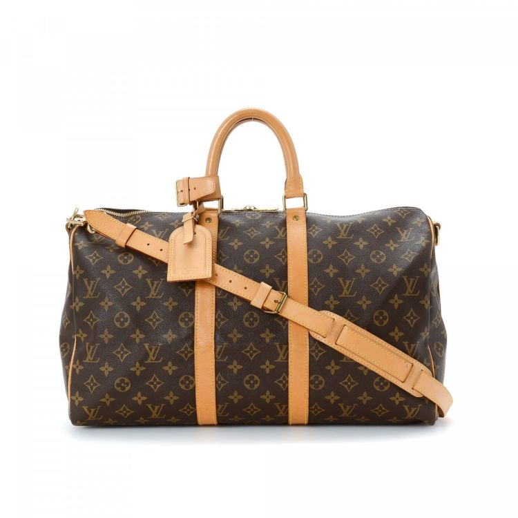 7a527e5f29995 The authenticity of this vintage Louis Vuitton Keepall 45 Bandouliere  travel bag is guaranteed by LXRandCo. Crafted in monogram coated canvas
