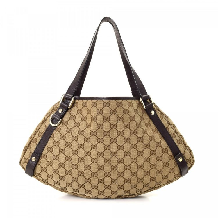 6ebedee2990 The authenticity of this vintage Gucci Abbey Tote shoulder bag is  guaranteed by LXRandCo. Crafted in gg canvas, this elegant bag comes in  beige.
