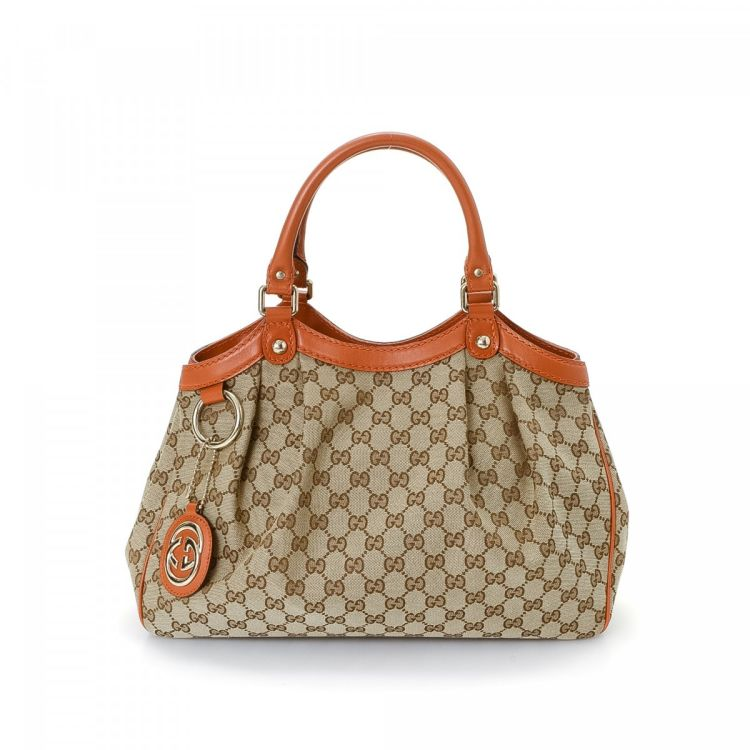 10945eb415a0 The authenticity of this vintage Gucci Sukey tote is guaranteed by LXRandCo.  This iconic work bag in beautiful beige is made in gg canvas.