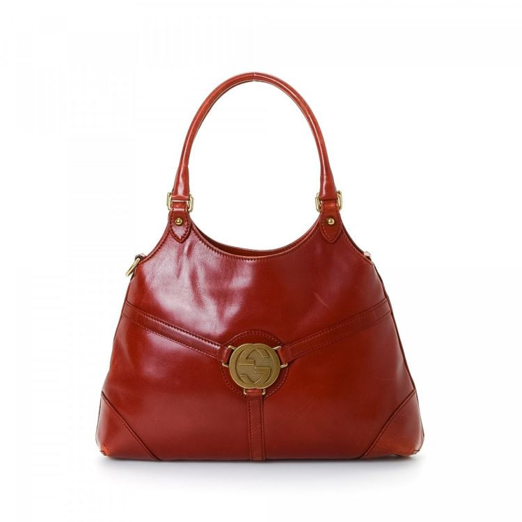 2a777f328 LXRandCo guarantees this is an authentic vintage Gucci Reins shoulder bag.  This lovely purse in beautiful red is made in interlocking gg leather.
