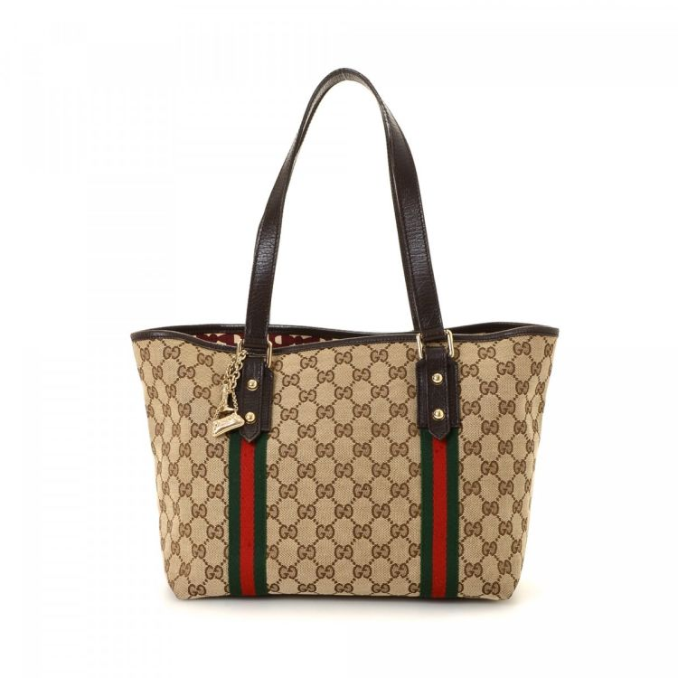 3d1605350336 LXRandCo guarantees the authenticity of this vintage Gucci tote. Crafted in  gg canvas, this signature work bag comes in beautiful beige.