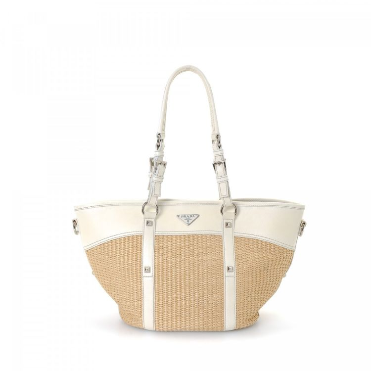55471328529a LXRandCo guarantees this is an authentic vintage Prada tote. This  sophisticated tote bag comes in beige raffia. Due to the vintage nature of  this product, ...